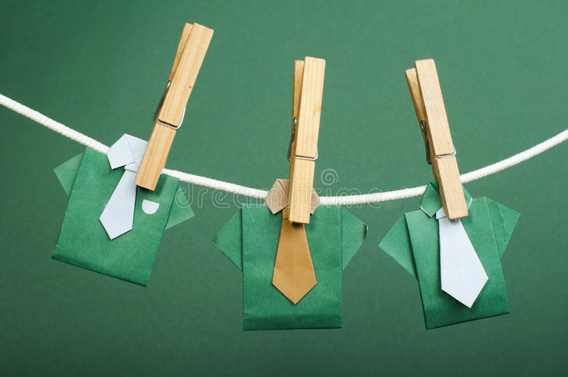 Origami shirts on rope royalty free stock photos