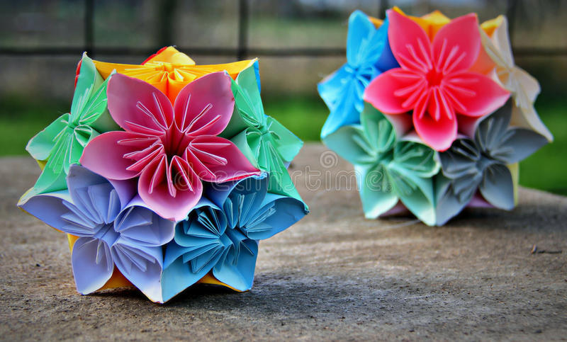 Origami spring flower balls. Origami paper kusudama flower balls in lovely pastel colors royalty free stock photos