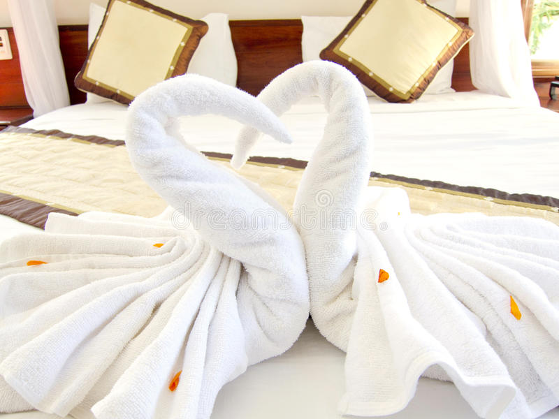 Origami Swan Towels Bed Decoration stock photo