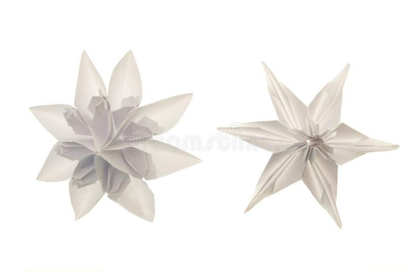 Origami white snowflakes stock images