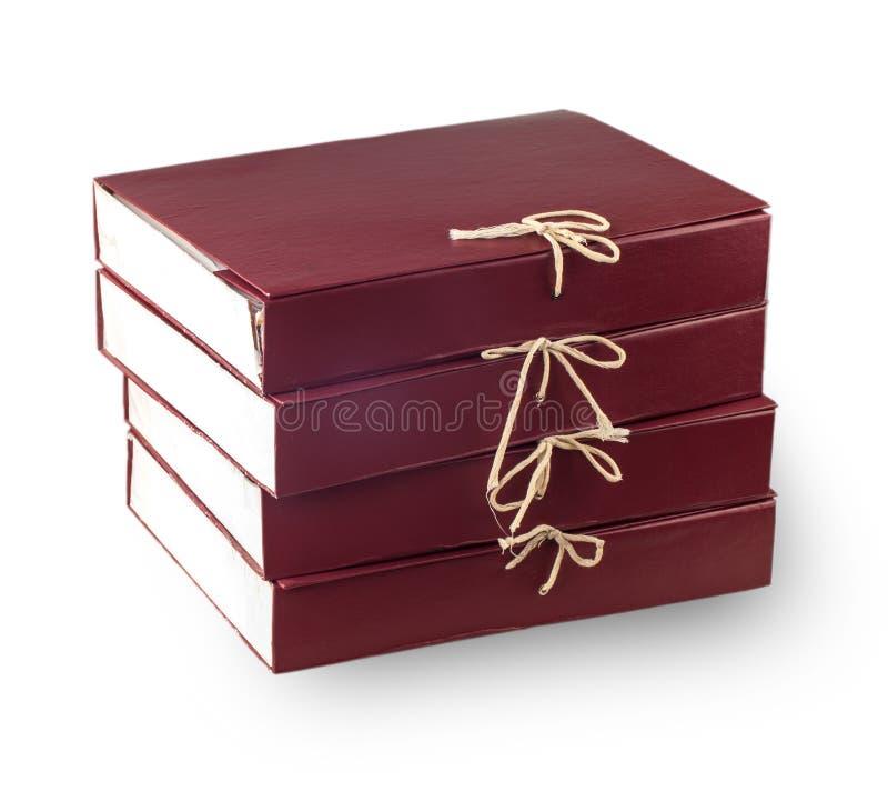 Originais de papel empilhados no arquivo isolado no branco imagem de stock royalty free