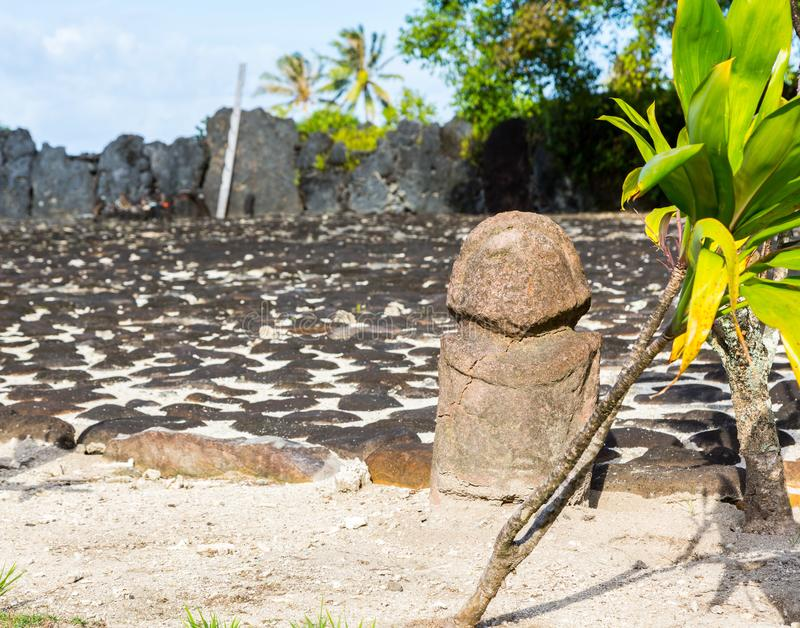 Original ancient stone carved tiki (Polynesian sacred idol statue), Marae Taputapuatea, Raiatea, French Polynesia. Original ancient stone carved tiki stock image
