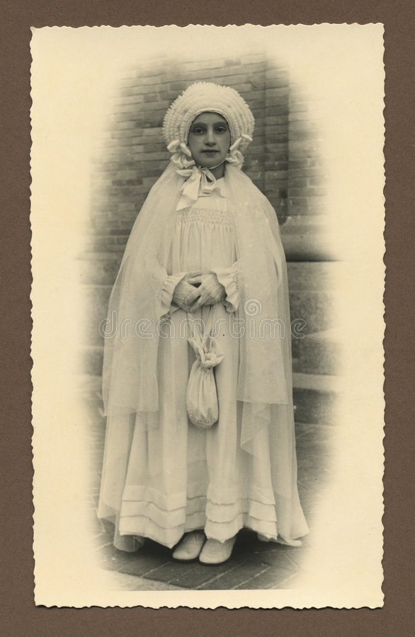 Original antique photo - first communion. This original antique photograph is of a young girl at her first communion taken in Italy probably in 1920 royalty free stock photos
