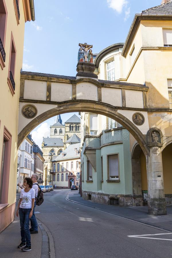 The original arch between the houses on the street in the central part of Trier stock photos