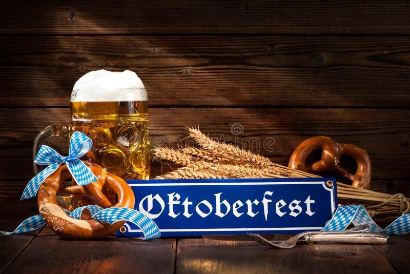 Original bavarian pretzels with beer stein. On wooden board. Oktoberfest background royalty free stock images