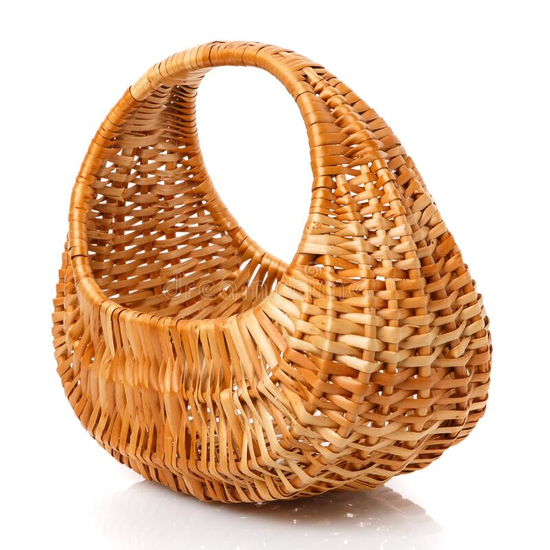 The original brown wicker basket is oval shaped made of vines on a white background royalty free stock image