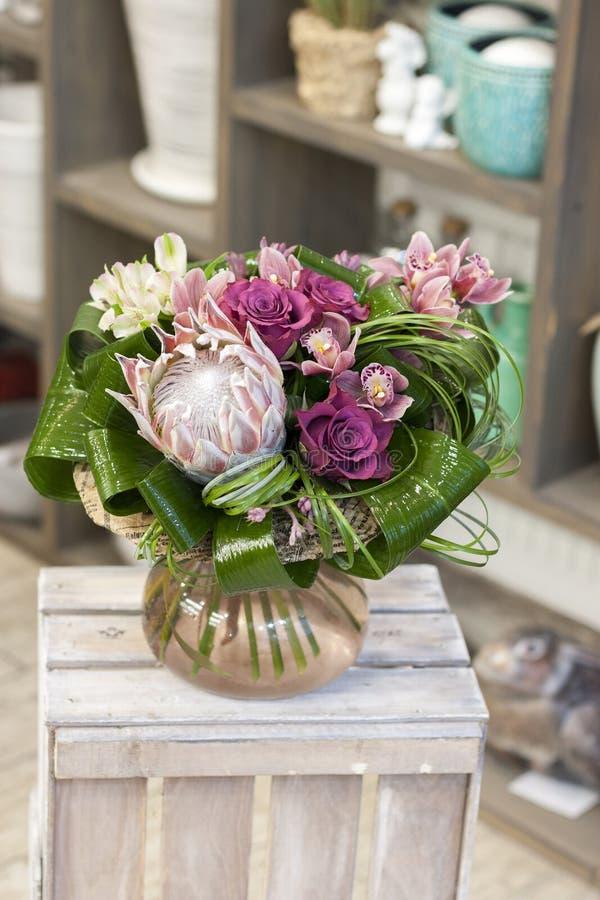 Original- bukett av blommor med exotiska blommor fotografering för bildbyråer