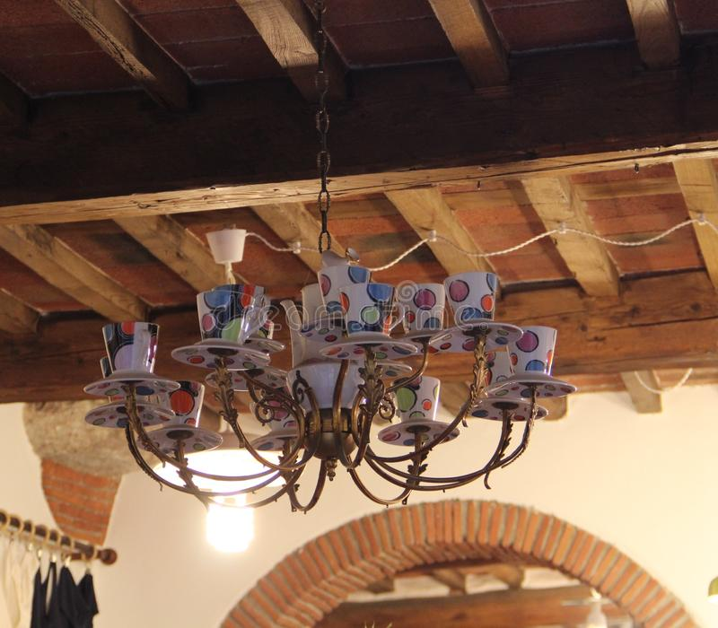 The original chandelier in the form of cups and saucers in the city of Lucca, Italy. royalty free stock image
