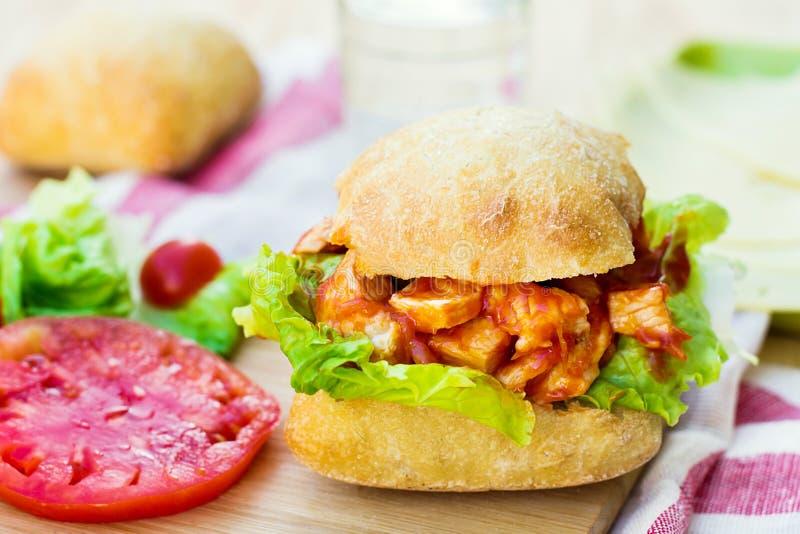 Original chicken sandwich burger with tomato sauce royalty free stock photo