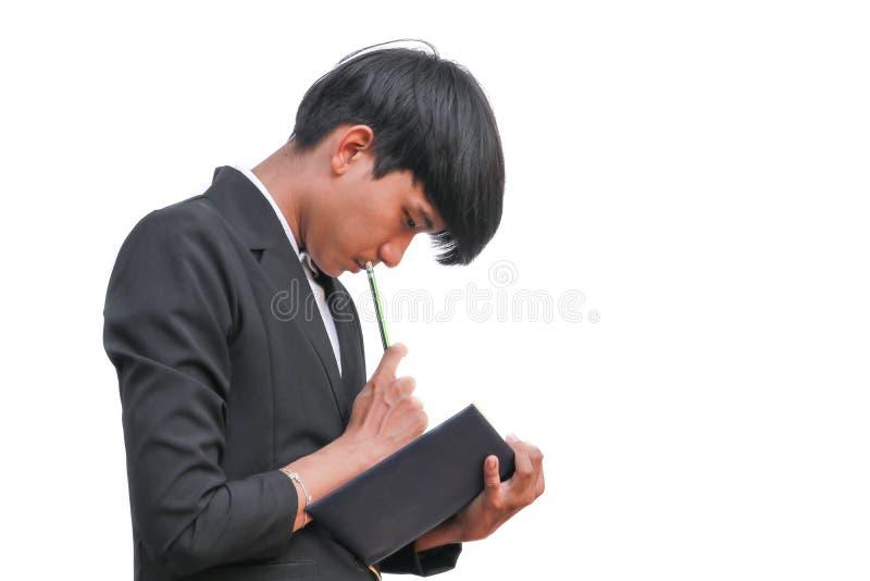 Original de registro de assinatura disponivel considerável do homem de negócios com o bloco de notas no fundo branco foto de stock royalty free