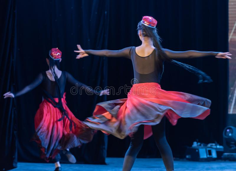 Girl Of Daban Town 5-Uygur Dance-Graduation Show of Dance Departmen. The original ethnic group of Xinjiang dance is the Uygur nationality. The dance is lively stock photo