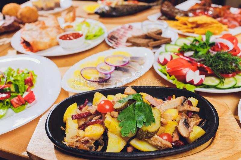 Original fajita sizzling smoking hot served on iron plate and fresh vegetables on background. stock photo