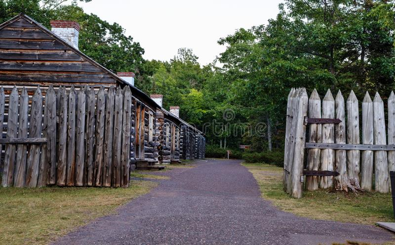 The Original Gated Community. A row of historical log cabins that once served as officers quarters at historic Fort Wilkins. Fort Wilkins State Park. Copper stock image