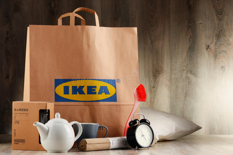 Original IKEA paper shopping bag and its products. POZNAN, POL - NOV 3, 2016: Founded in Sweden in 1943 IKEA is world's largest furniture retailer, operates 384 stock photos