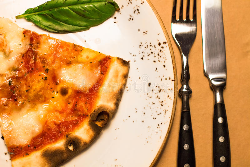 Original italian Pizza Margherita with cheese and tomato sauce royalty free stock photography