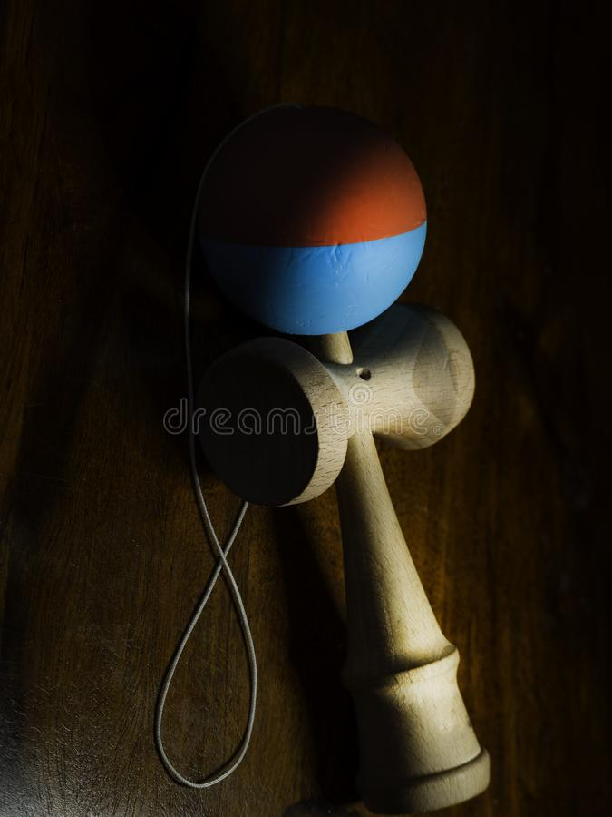 The original Kendama. Traditional, wooden Japanese skill toy for children. Has three cups, spike and ball, selective focus royalty free stock photos