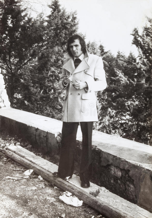 Original 1970 photo, vintage italian man outdoor. Fashion clothing. royalty free stock photos