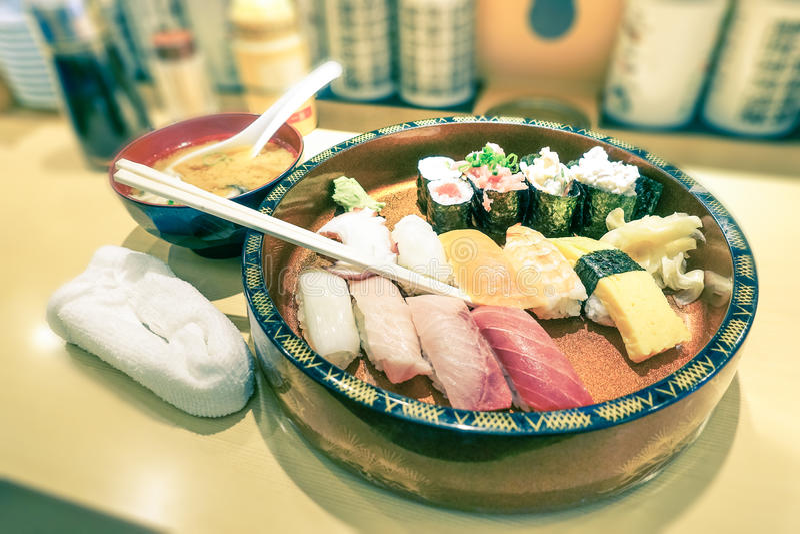 Original plate of sushi nigiri at japanese restaurant in Tokyo royalty free stock image