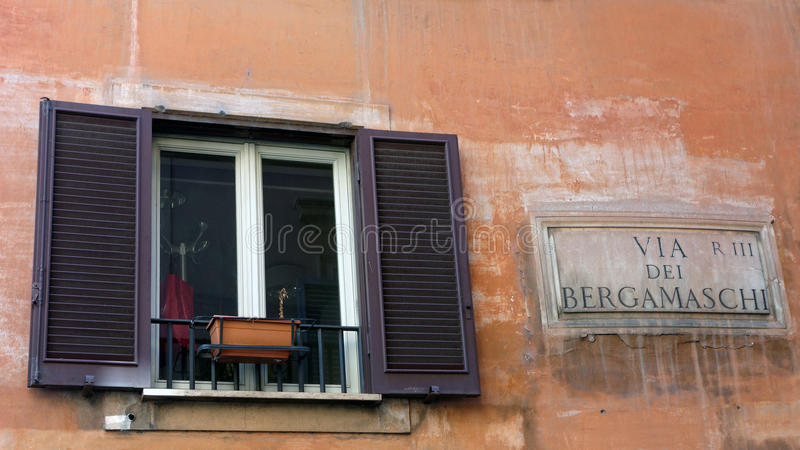 Original Rome Building and Street Sign royalty free stock images