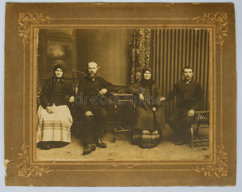 Original 1900s antique photo of a four people stock photo