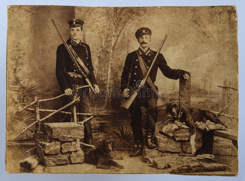 Original 1900s antique photo of two hunters stock photography