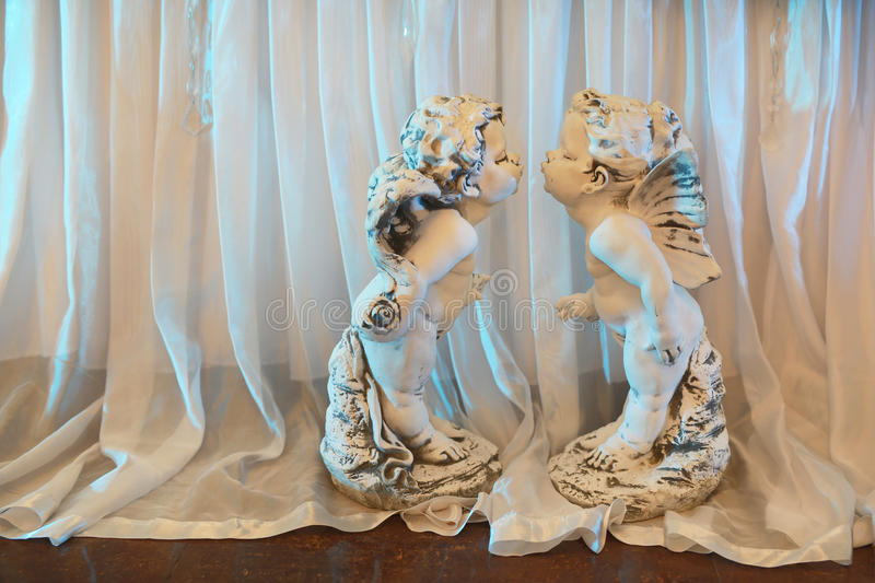 Original statuettes in the form of angels. From stucco on a wedding day royalty free stock images