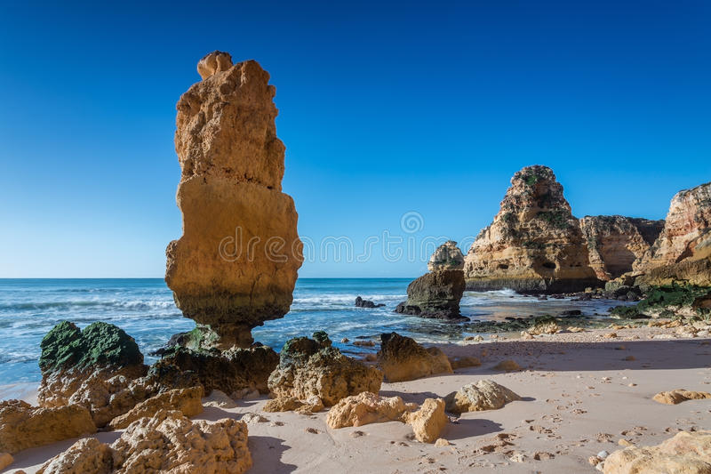 The original stone mountain on the beach. Portugal. royalty free stock photography