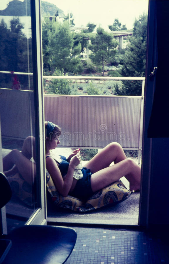 Original vintage colour slide from 1960s, young woman relaxing a stock photos