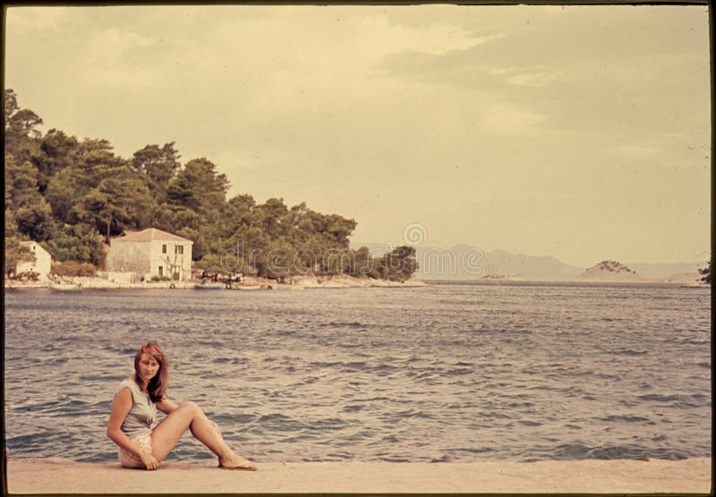 Original vintage colour slide from 1960s, young woman sitting by stock images