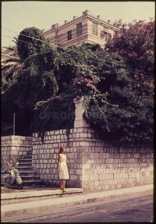 Original vintage colour slide from 1960s, young woman standing i royalty free stock images