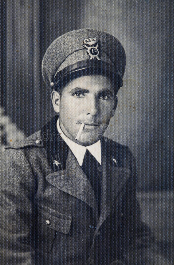Original vintage 30s photo portrait Italian military man. Original photo of the 30 years of a young Italian military uniform and with cigarette in his mouth royalty free stock images