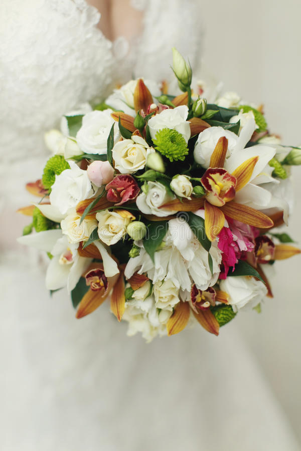 Original wedding bouquet of white roses and greenery.  stock photography