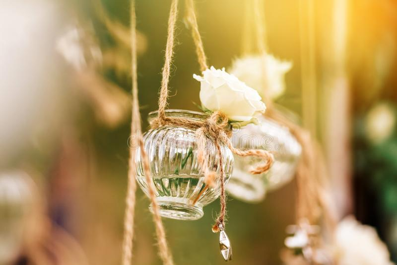 Original wedding floral decoration in the form of mini-vases and bouquets stock photos