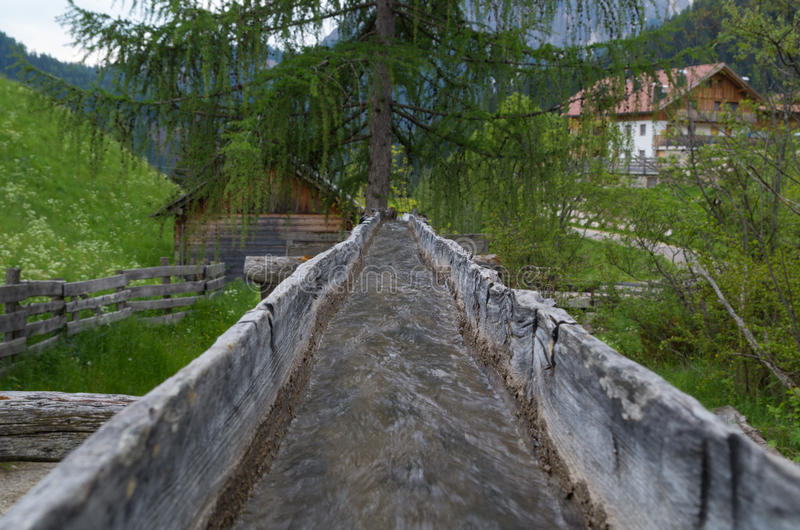 Original wooden irrigation water channel of a mill in italy stock images