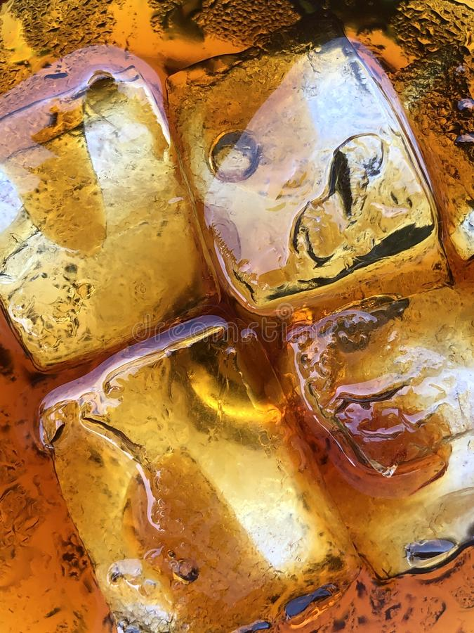ice cubes in coffee or coke royalty free stock photography