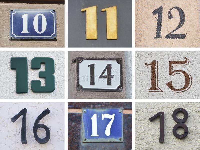 Originele huisnummers 10 tot 18 stock afbeelding