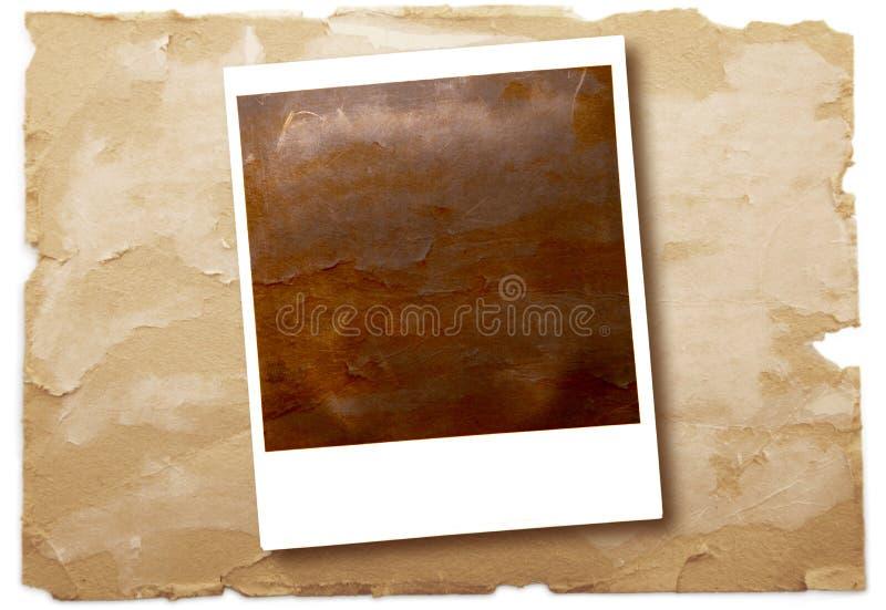 Originele polaroid op uitstekende document achtergrond stock foto