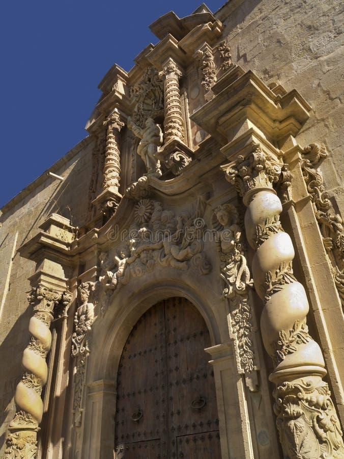 Orihuela - Costa Blanca - Spain. Ancient carved doorway to the Church of Las Santas Justa-y-Rufina in the town of Orihuela on the Costa Blanca in Spain royalty free stock photos
