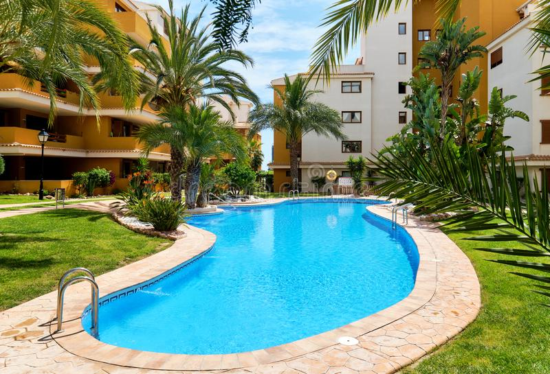 Orihuela, Spain- May 9, 2019: Idyllic place for vacationers residential high rise building house with swimming pool closed royalty free stock images