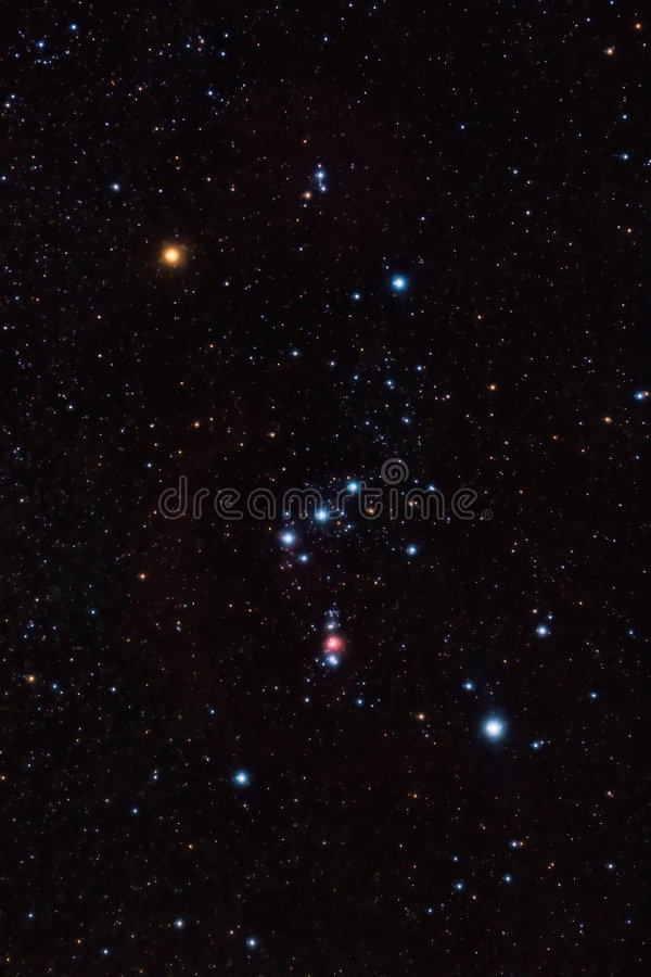 Orion Constellation. And nebula among background stars stock image