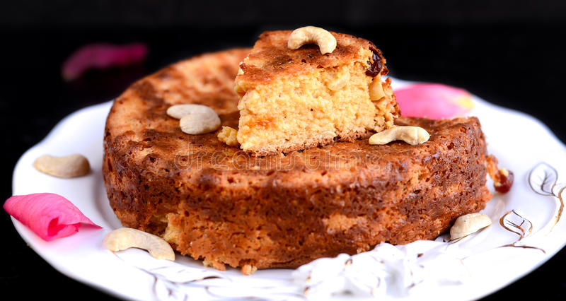 Oriya Sweet - Chenna Pudo. Chenna Pudo-is an Oriya dessert created with milk and sugar ,Indian cake created with chenna or paneer or cottage cheese baked with stock image