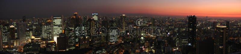 Orizzonte di Osaka al tramonto fotografie stock