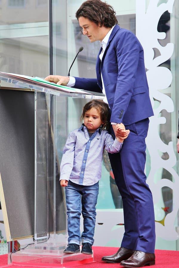 Orlando Bloom /son Flynn image stock