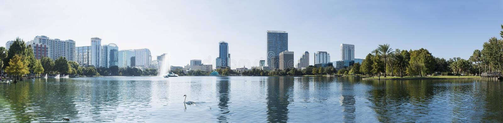 Orlando downtown Lake Eola panorama with urban buildings and reflection royalty free stock images
