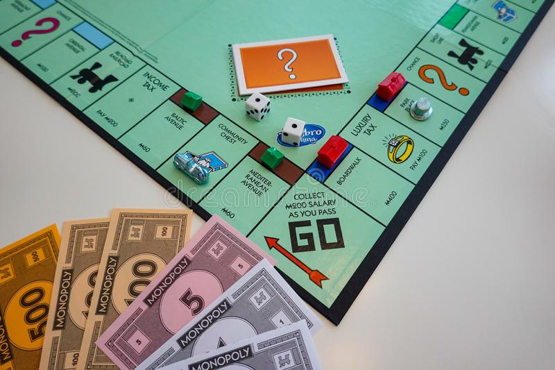 The Board and pieces for the game Monopoly by Hasbro. Orlando,FL/USA-8/29/19: The board and pieces for the game Monopoly by Hasbro on a white background royalty free stock photos