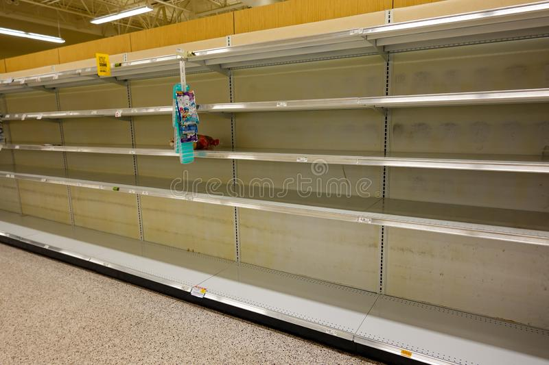 Empty grocery store shelves of bottled water before a hurricane or snow storm.  before a hurricane or snow storm. Orlando,FL/USA-8/30/19: Empty grocery store royalty free stock images