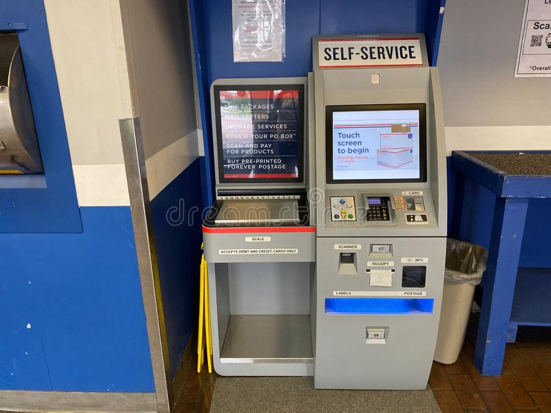 A self service postage machine in an United States Postal Service, USPS, office. Orlando,FL/USA-10/7/19:  A self service postage machine in an United States royalty free stock images
