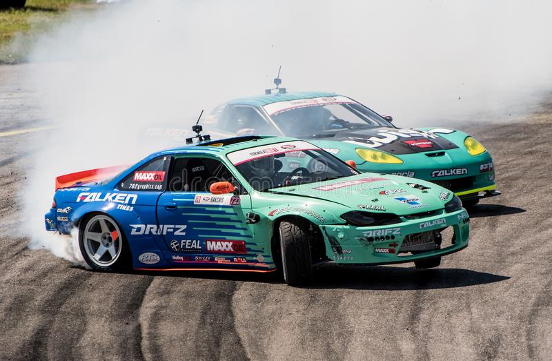 Formula Drift Orlando. Orlando, Florida – April 28, 2018: Drivers compete in Round 2 of Formula Drift in Orlando, Florida, on April 28, 2018 royalty free stock photography