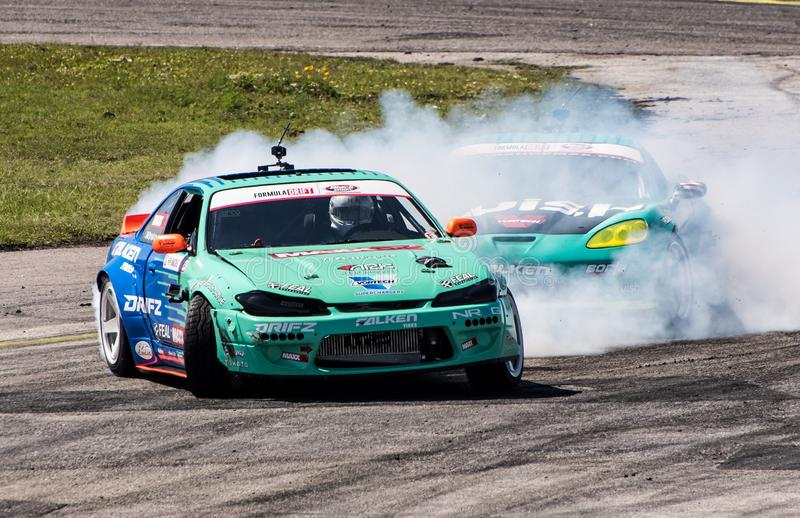 Formula Drift Orlando. Orlando, Florida – April 28, 2018: Drivers compete in Round 2 of Formula Drift in Orlando, Florida, on April 28, 2018 royalty free stock images