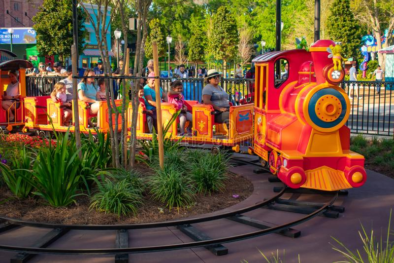 Parent and Kids enjoying colorfur Elmo`s Choo Choo Train at Seaworld in International Drive area  1. Orlando, Florida. April 7, 2019. Parent and Kids enjoying stock photo